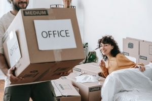 a couple renting an office space in Baltimore and packing
